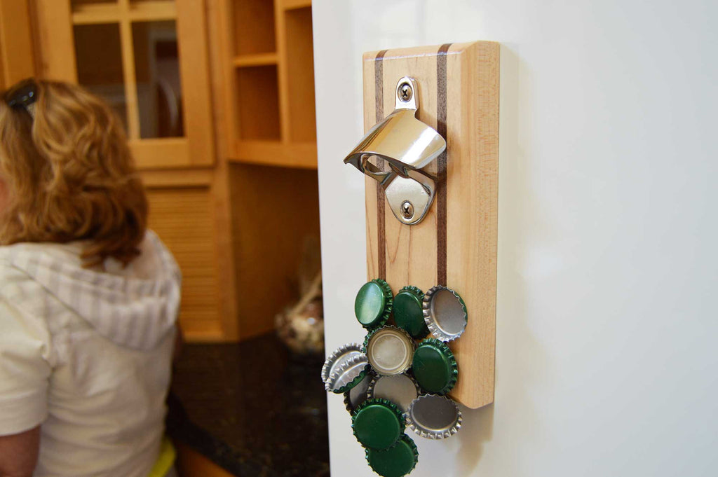 Maple and walnut magnetic bottle opener by Nason's of Maine on a fridge