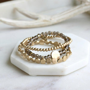 gold and brown beaded stacked bracelet stack