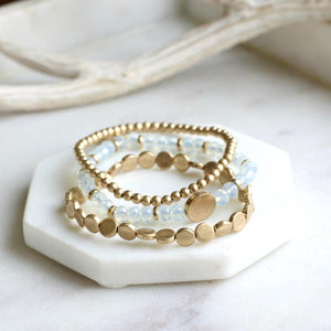 clear and gold bead bracelet stack