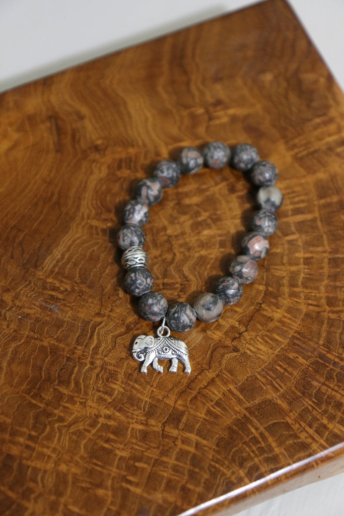 Elephant Bracelet on wood - Bracelets That Give Back