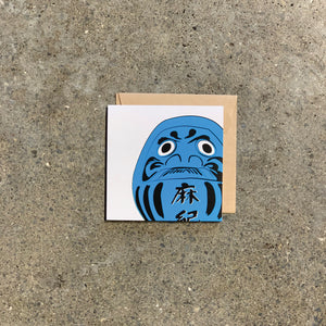 Blue Daruma on White Greeting Card