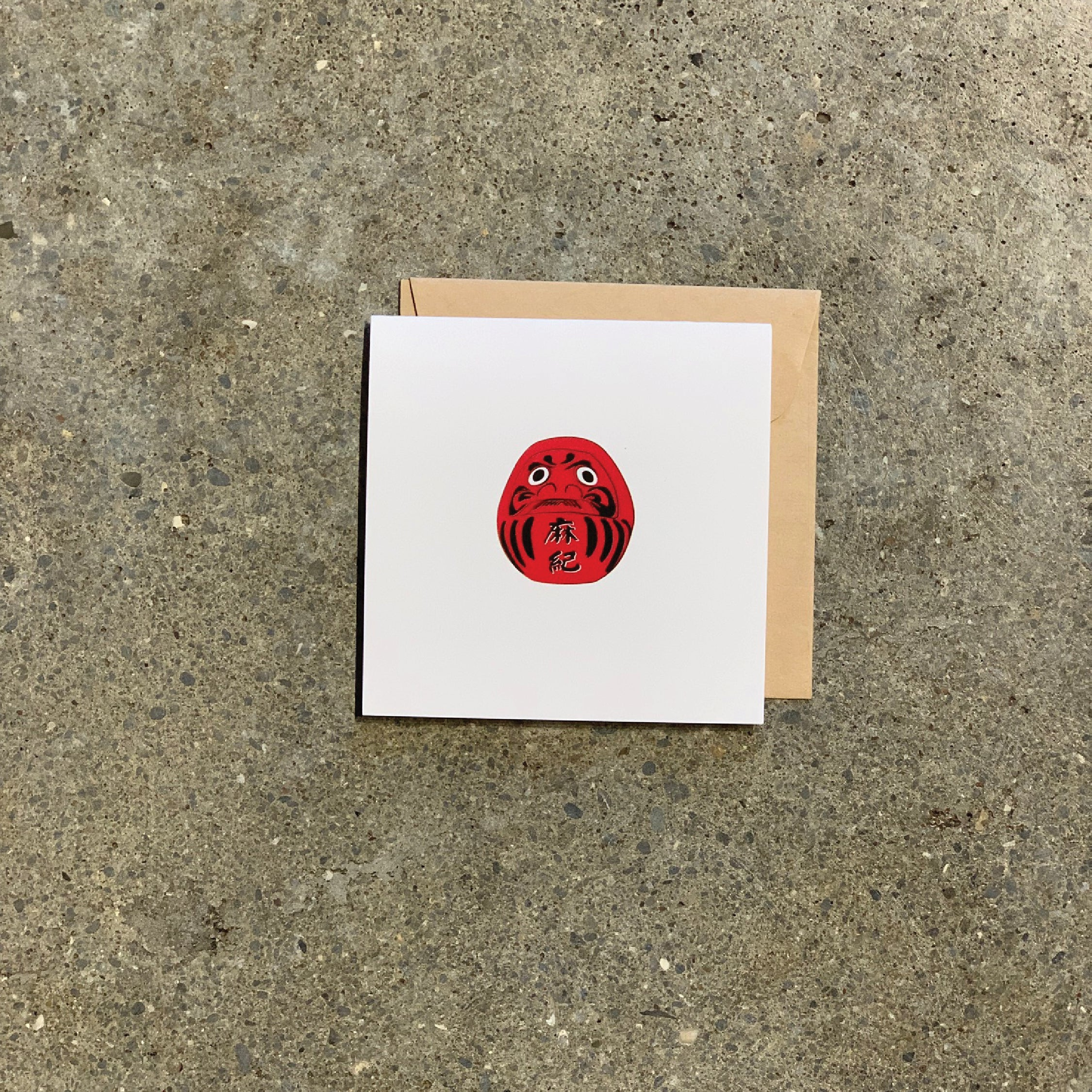 Red Daruma on white Greeting Card