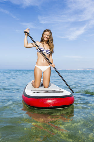 Woman stand up paddle boarding-SUP