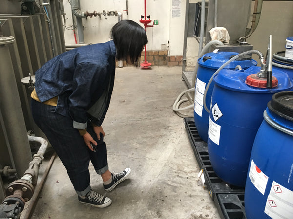 Auditor Jian checking the storage of chemicals used in the production process.