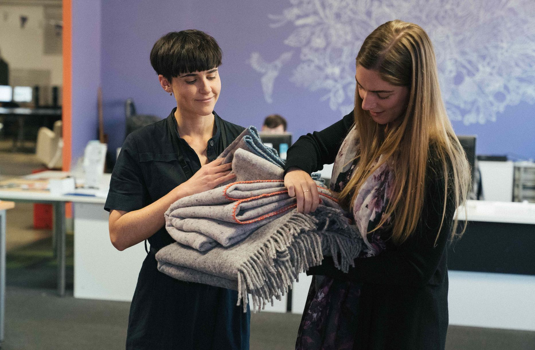 Karina donating blankets to the ASRC