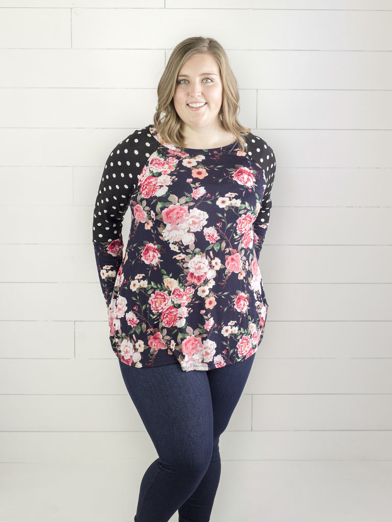 Plus size mixed pattern long sleeve with black and white dot and pink floral pattern from Simply Fate Clothing.