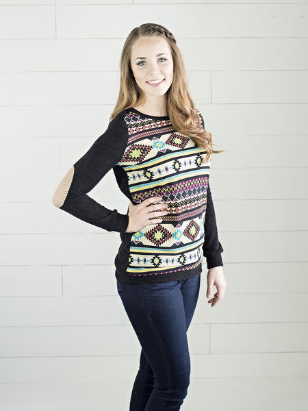 Woven long sleeve top with Aztec print front and solid black back by Simply Fate Clothing.