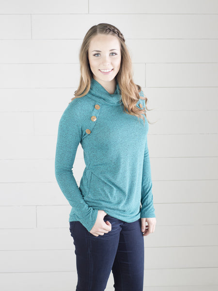 Heathered teal tunic with slight cowl neck and button detail on shoulders by Simply Fate Clothing.