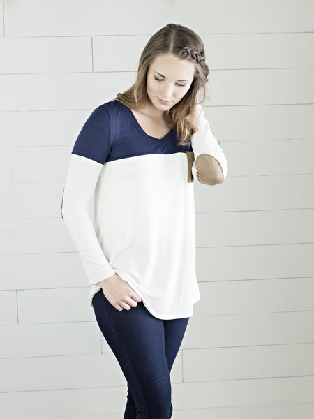 Long sleeve top with color accent and faux suede pocket and elbow patches from Simply Fate Clothing.