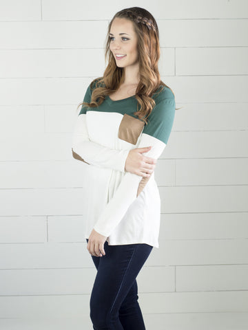 Long sleeve top with color accent and faux suede pocket and elbow patches from Simply Fate Clothing..