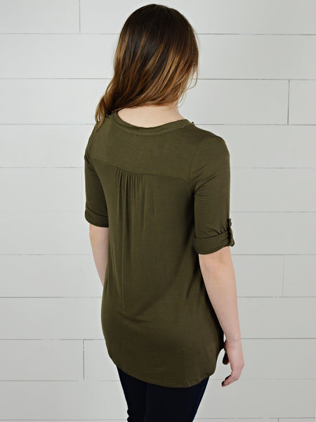 Back view of olive colored, three quarter sleeve, casual top, with rolled cuff and button tab from Simply Fate Clothing.
