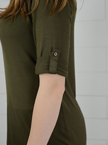 Close up detail view of olive colored, three quarter sleeve, casual top, with rolled cuff and button tab from Simply Fate Clothing.