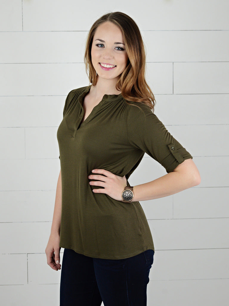 Olive colored, three quarter sleeve, casual top, with rolled cuff and button tab from Simply Fate Clothing.