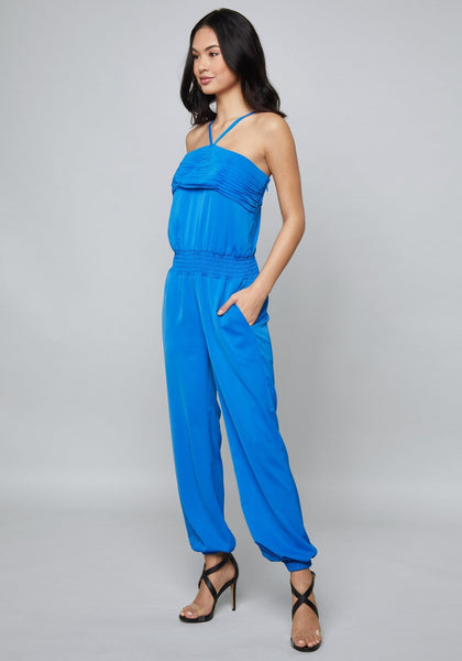 SMOCKED STRAPPY JUMPSUIT Day Jumpsuits - bebe Arabia