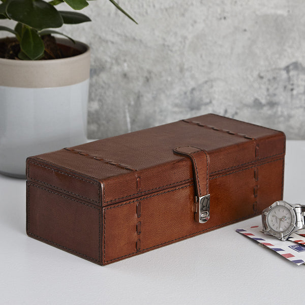 Closed brown leather watch storage box