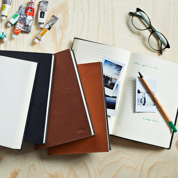 Leather covered notebooks in three colours and two sizes