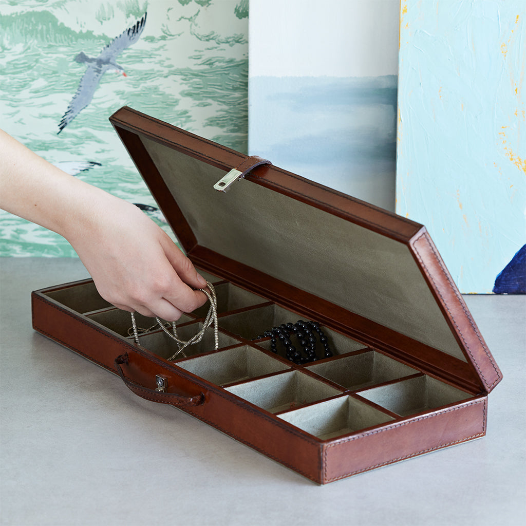 Cufflink case open with hand