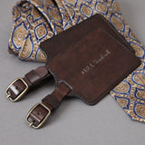 Dark brown leather luggage tags