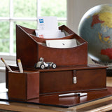 leather letter rack sitting on top of box file, with pen pot and desk mat