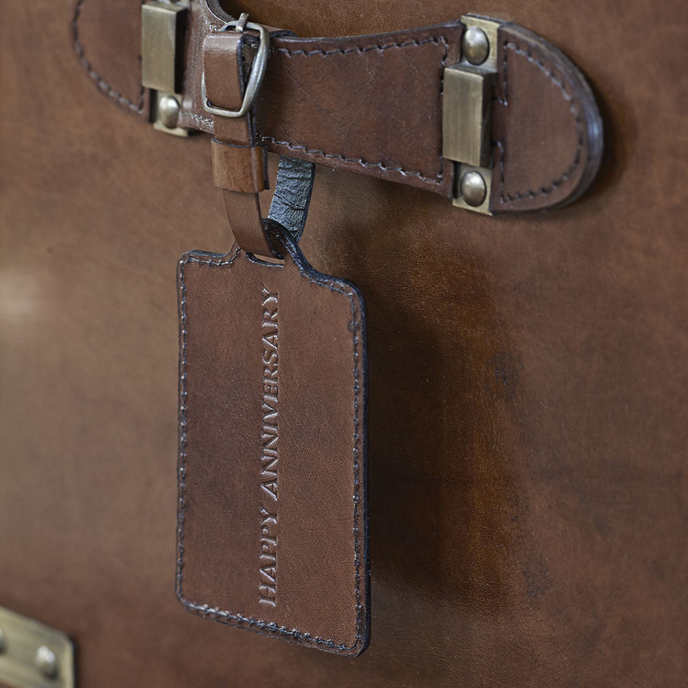 attach a personalised leather luggage tag to the drinks box