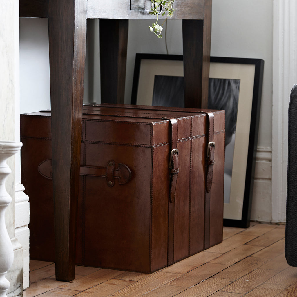 Medium leather cabin trunk in hallway