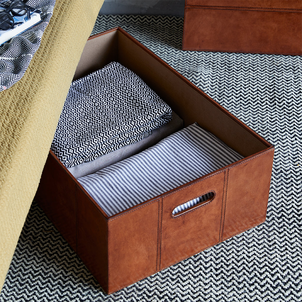 Underbed leather storage box shown without lid