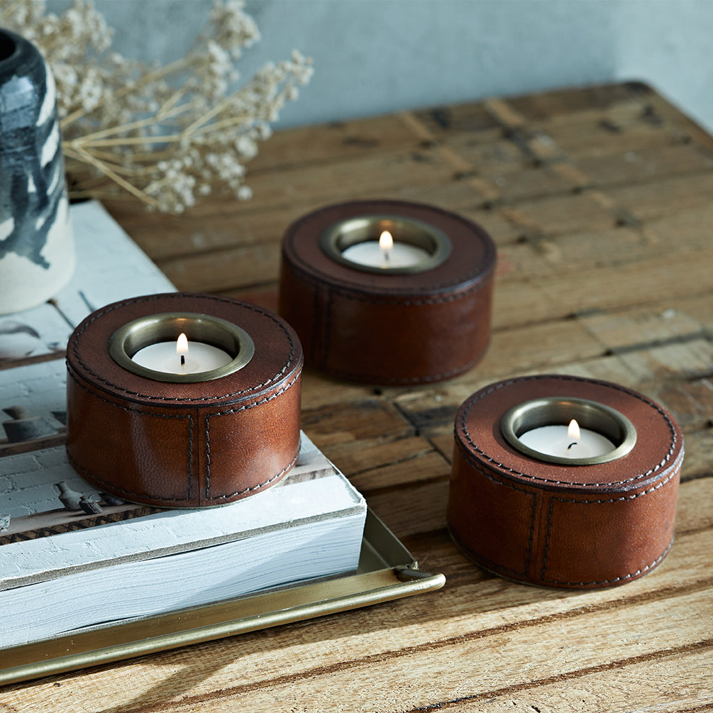 set of three leather tea light holders