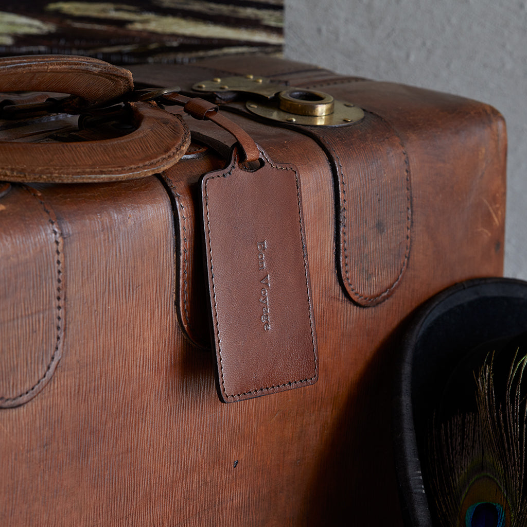 Conker brown leather luggage tag on suitcase