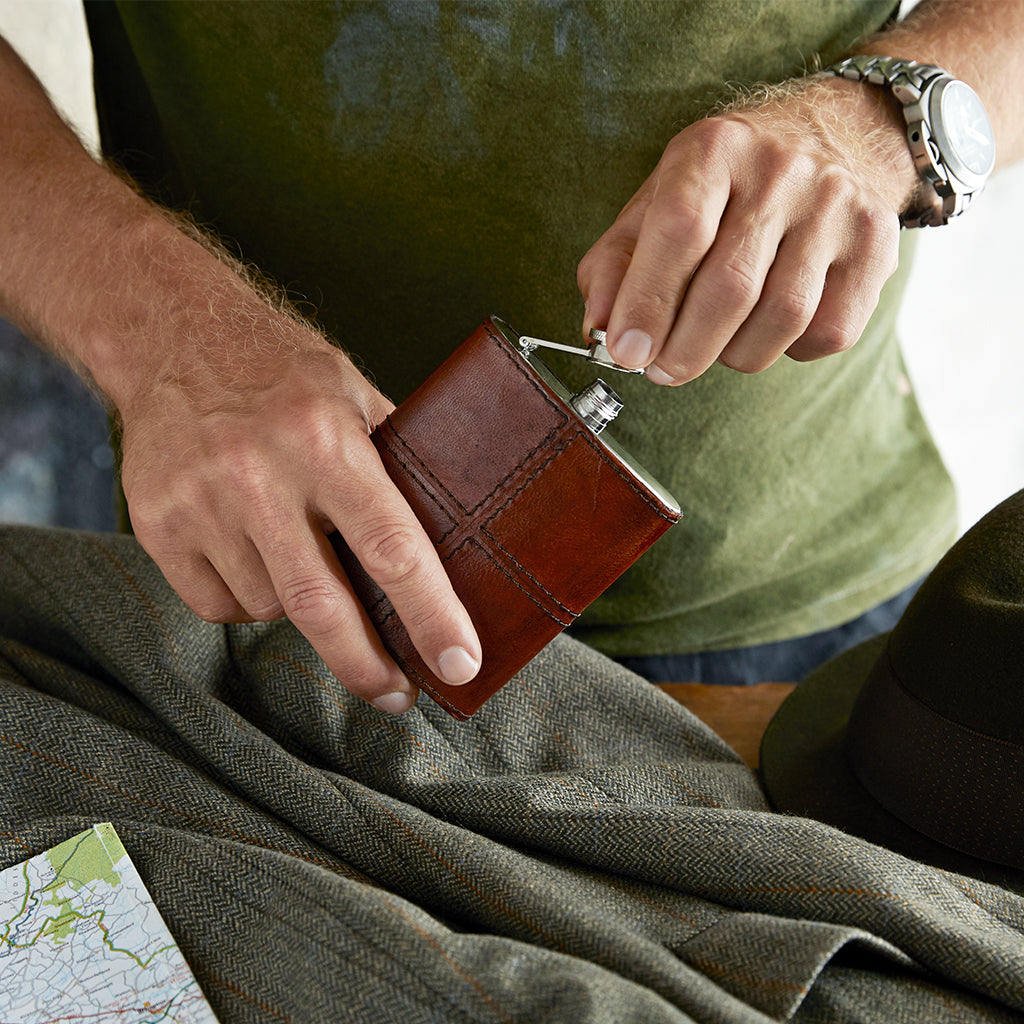 conker brown hip flask in use