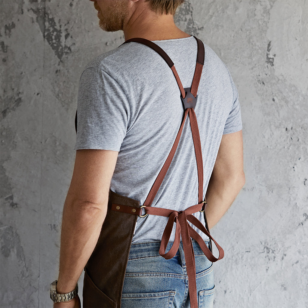 Waxed canvas and leather apron tied at the back#