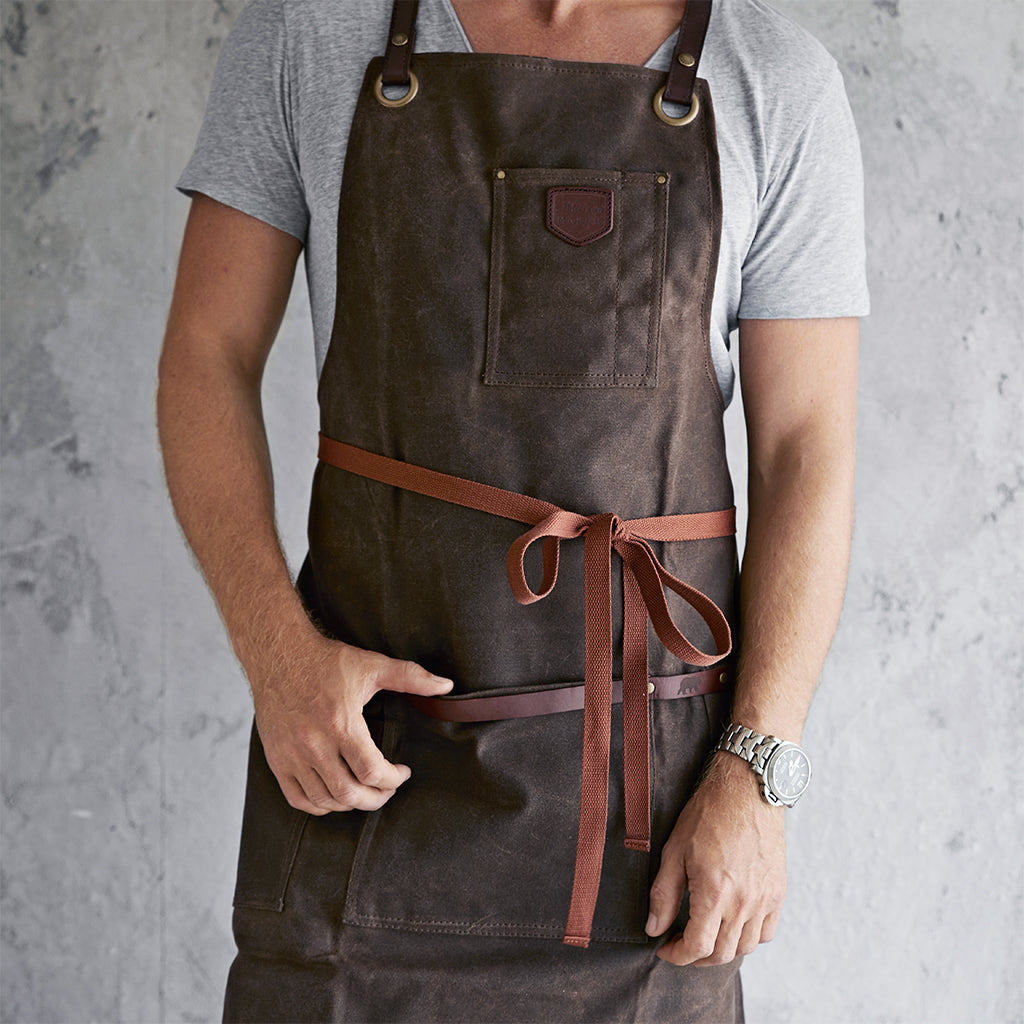 Waxed canvas and leather apron tied at the front