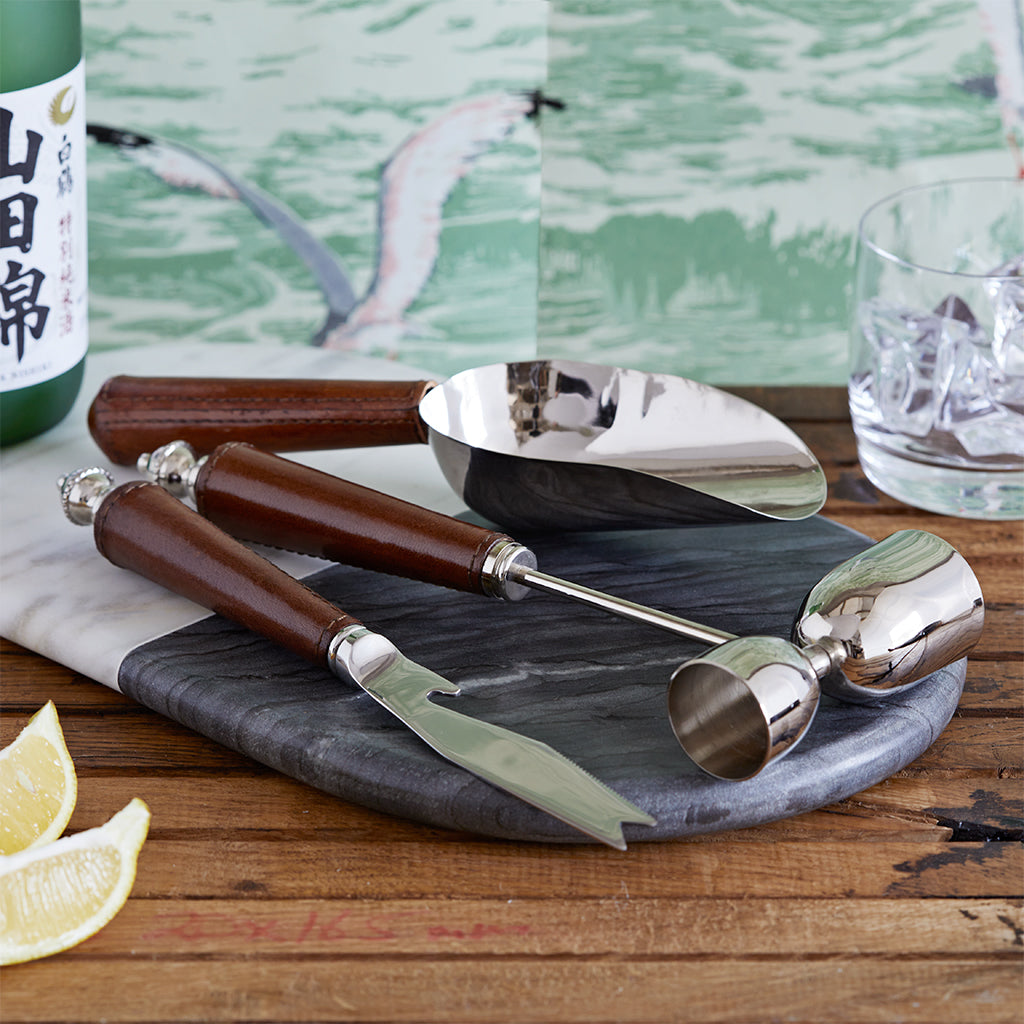 Garnish knife, spirit measure and scoop with leather handle