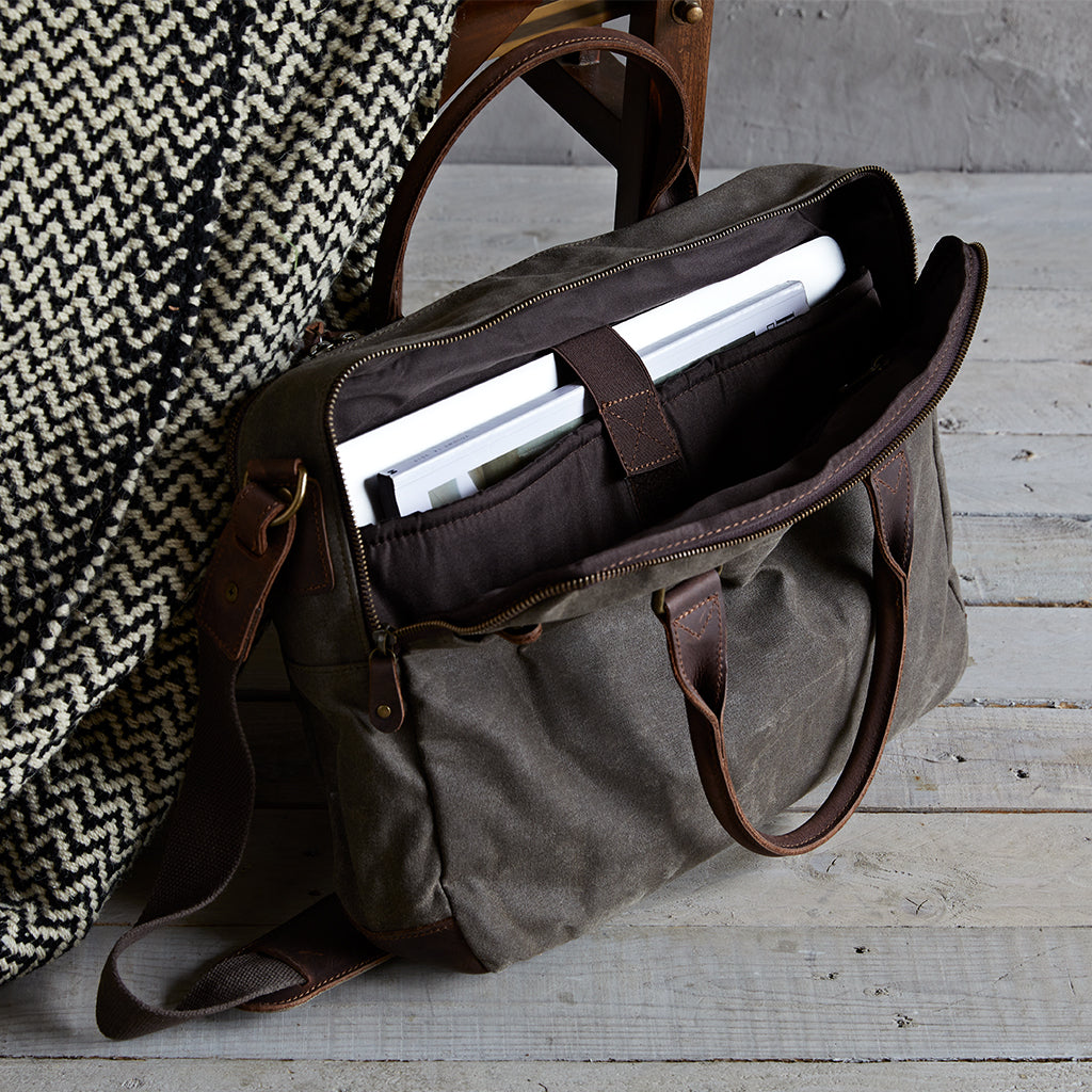 open canvas and leather laptop bag