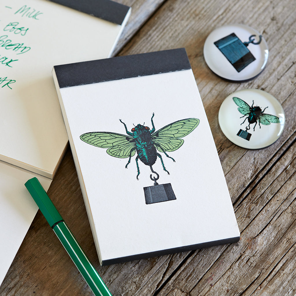 fly notebook and magnets