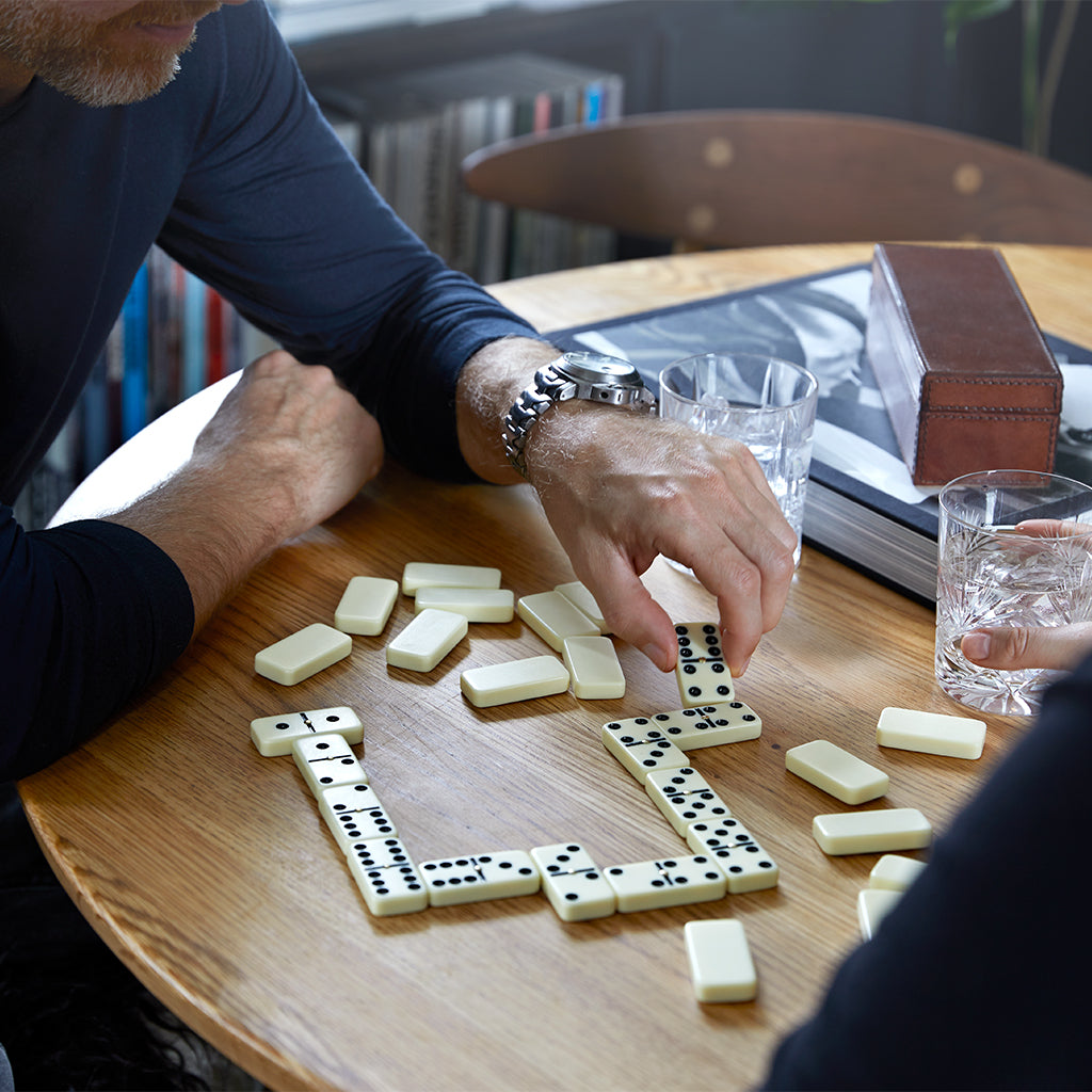 playing dominoes with family