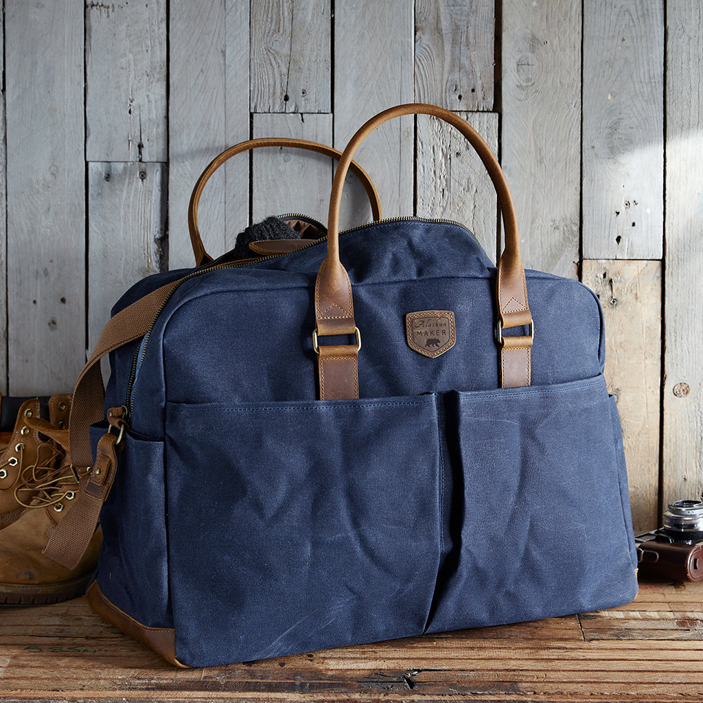 Navy waxed canvas weekend bag with leather handles