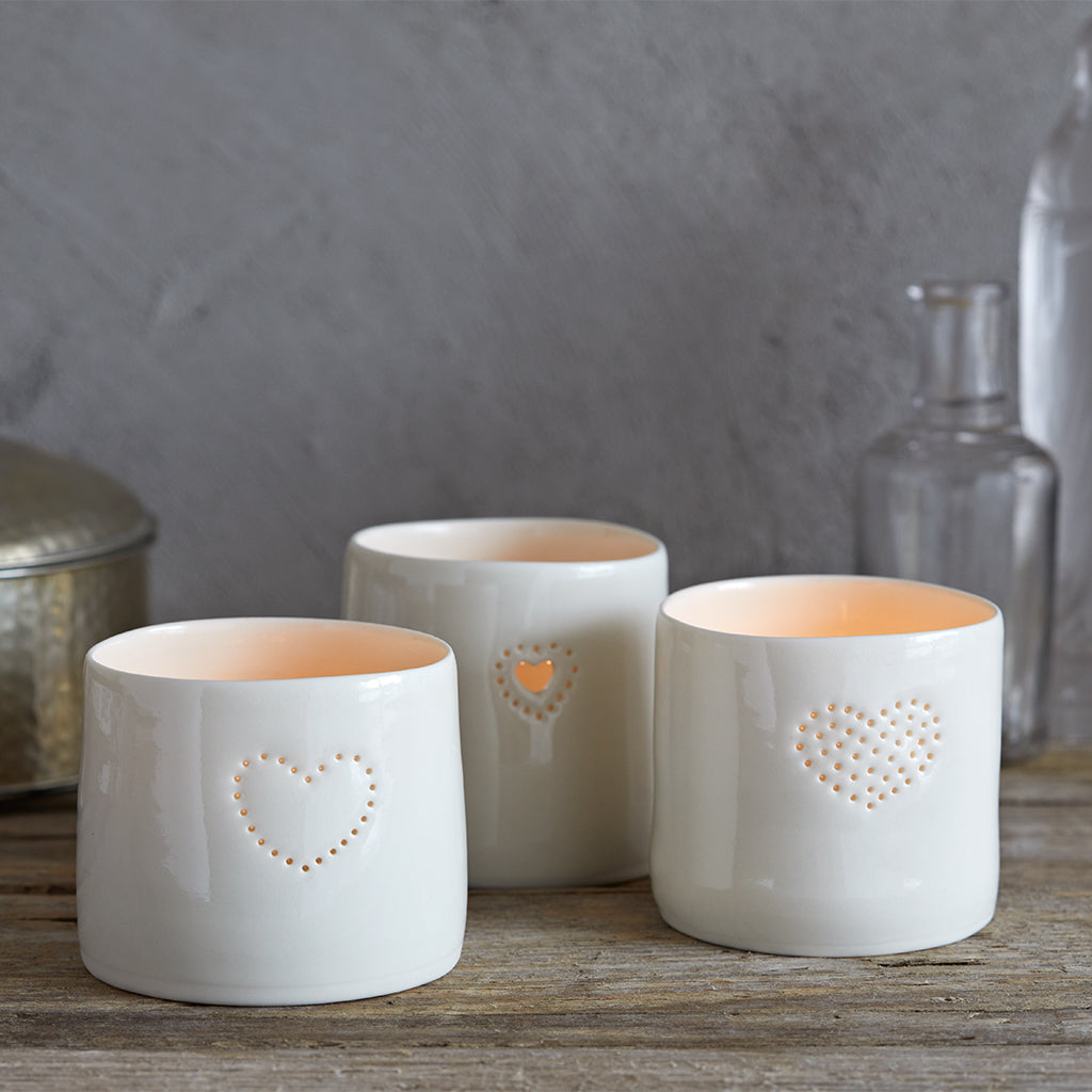 set of three heart porcelain tea light holders