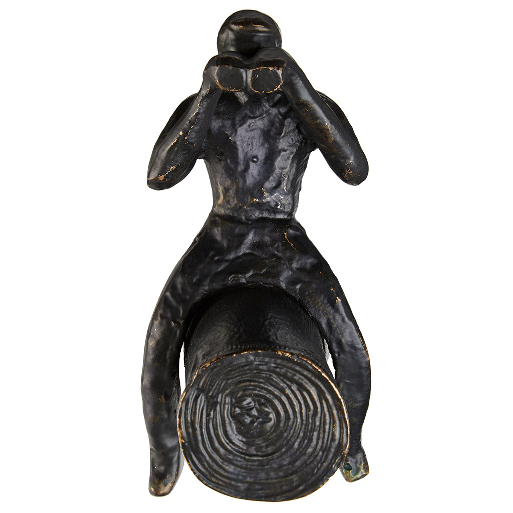 Man on log decorative hook face on