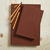 Dark brown leather notebook with lined or plain paper