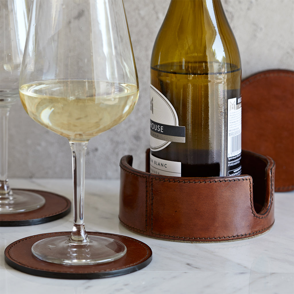 Wine bottle coaster holder with wine bottle