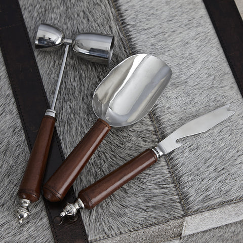 three leather handled cocktail tools for a bar set