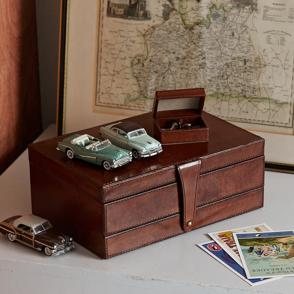 Men's jewellery box closed with travel cufflink box in conker brown leather