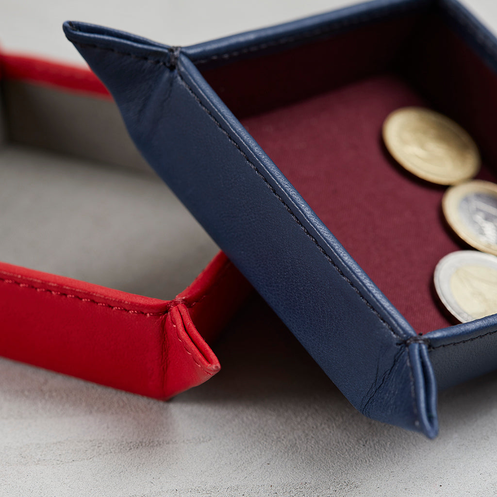 Close up of navy leather coin tray