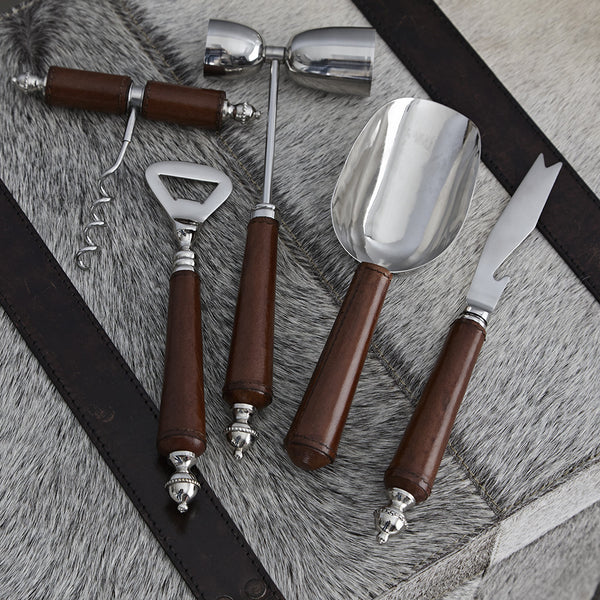 five leather handled bar tools