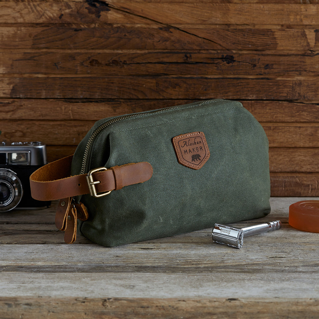 closed khaki toiletry bag