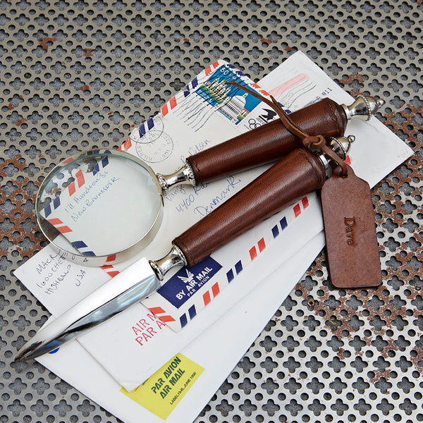 Letter opener with magnifying glass