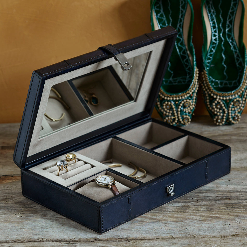 Slim jewellery box showing inside compartments