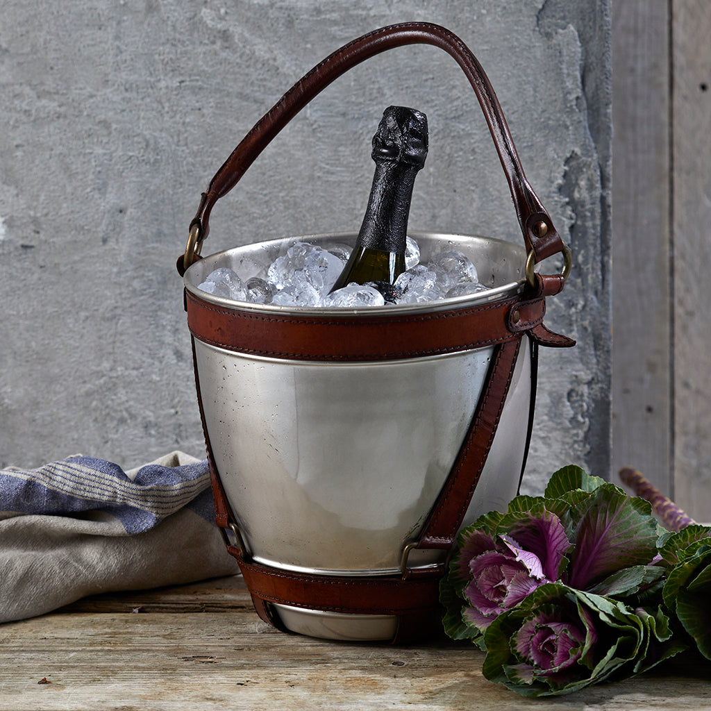 nickel champagne cooler filled with ice