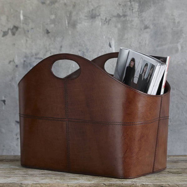 Curved leather basket with magazines