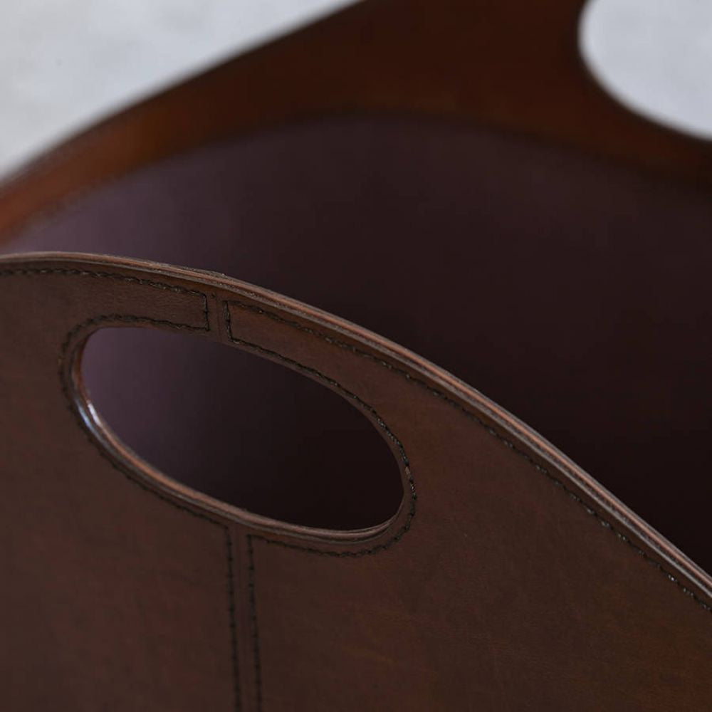Close up of oval handles on leather basket